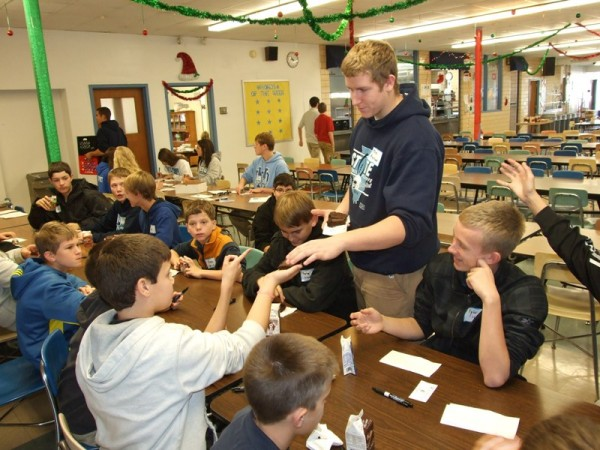 Student Ambassador Joe Hemann serves brownies to eighth graders from St. Rose Grade School during the students' eighth grade visit to Mater Dei. The students were able to visit classes in progress, tour parts of the campus, and partake in a snack of brownies and milk in the cafeteria. Also participating in eighth grade visits this past week were students from St. Paul-Highland and St. Clare-O'Fallon. The visits for other area eighth graders will continue throughout December.