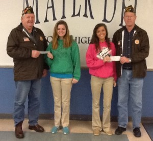 """Allison Henrichs (right) accepts her 1st Place award from Mike Haselhorst of the Trenton VFW Post 7983 that sponsored the Voice of Democracy writing contest and Zoe Timmermann (left) accepts her 2nd Place award in the writing competition from Jim Ottensmeier, also from the Trenton VFW. The topic for this year's essay was """"Is the Constitution still relevant?"""" Both students won $500 for her winning essay."""