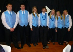 Joe Hemann, Ben Lampe, Jaynee Albers, Riley Rickhoff, Lucy Hummert, Alexis Voyles, and Shannon Mensing were among those students who volunteered as runners at the auction.