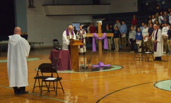 Fr. George Mauck reads a passage during the Lenten Reconciliation Service at Mater Dei. The juniors and seniors attended the service in the morning and the freshmen and sophomores in the afternoon. Students had time to pray, reflect, and go to confession.