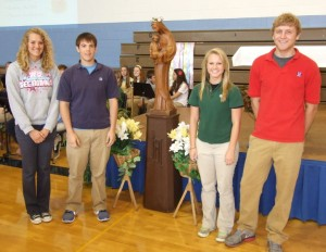 Senior class officers Jade Beckmann, Alex Gebke, Maddy Mensing, and Cameron Beer participated in the Crowning of Mary to open the May Mass on May 7.