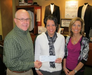 Becker Jewelers generously donates $4.00 to Mater Dei for each tuxedo rental by an MD student. A.G. and Angie Becker of Becker Jewelers present Mrs. Maria Zurliene with the check, which will be given to the MD sophomore class to use for next year's prom.