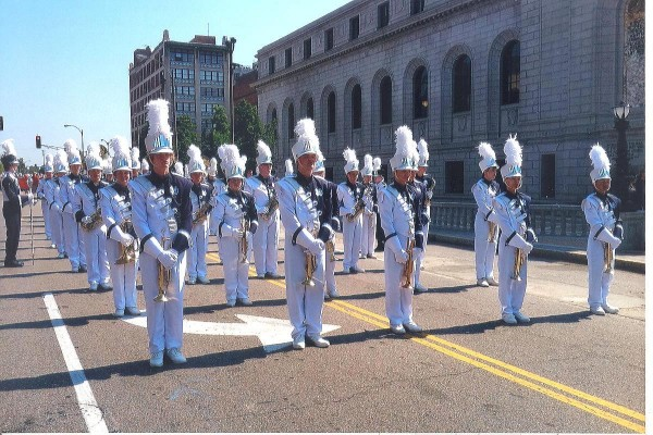 Members of the Marching Knights stand at parade rest waiting for the parade to begin.