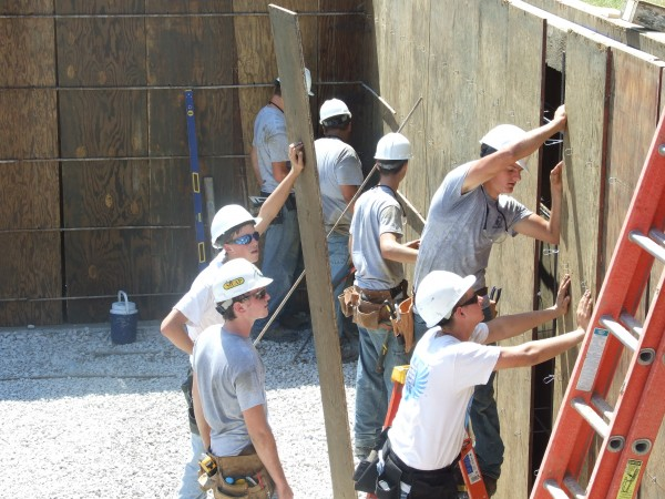 Our students prepare the basement walls of the 2013-2014 Building Trades home.