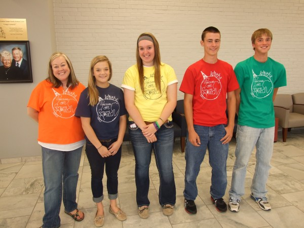 Senior Lexi Kohnen designed the 2013 Homecoming t-shirts that students and staff represent to kick off the week of Homecoming festivities .