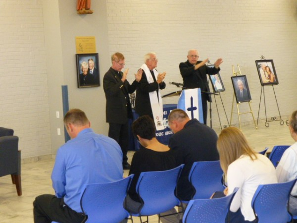 Former Bishop Stanley Schlarmann (center), Father Chuck Tuttle (left), and Father Dan Friedman (right) bless the newly renovated Student Center during the Dedication Ceemony.