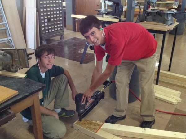 Students from Mr. Denaro's Woodworking Class build a part of the Santa Hut for the City of Breese.