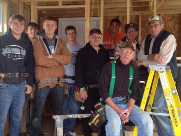 Building Trades class along with the help of some volunteers prepare Santa's Hut for the community.