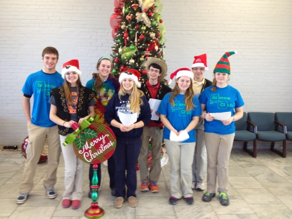 "MD science club members sing Christmas songs in the ""Lampe Commons""."