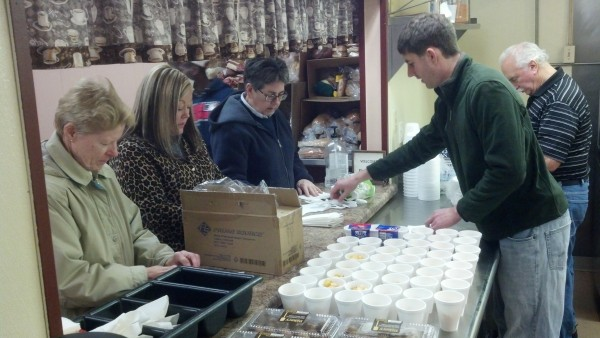 MD faculty members spent the day last week serving meals at Cosgrove's Kitchen.