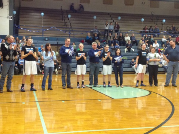 MD senior girls basketball players are recognized with their parents.
