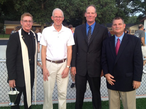 Father Chuck Tuttle, Mr. Tom Rehkemper, Mr. John Wieter, and Principal Dennis Litteken participated in the blessing and dedication of the new athletic field.