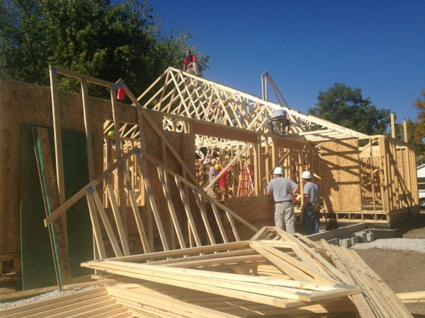 Building trades class puts up the rafters for the roof.