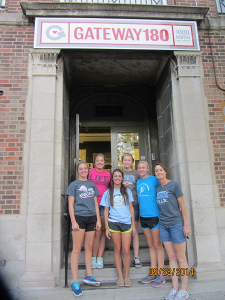 Mater Dei students recently visited Gateway 180, a homeless shelter where they prepared and served meals for over 50 residents.