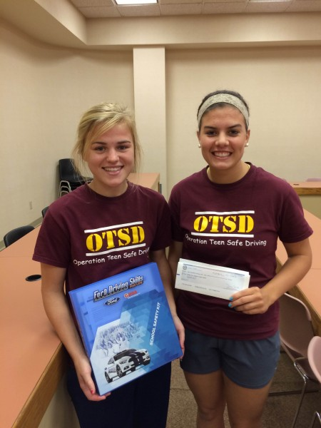 Maggie Fields and Shannon Schuetz receive a $2000 grant for the Operation Teen Safe Driving organization.