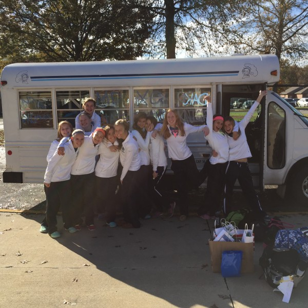 MD girl's cross country team get ready to load bus and head to Peoria for the state meet.