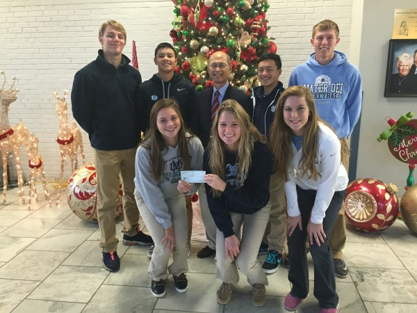MD FBLA members present Dr. Renato Rivera a check for $1,270 to used for the  Operation Giving Back Bohl Mission