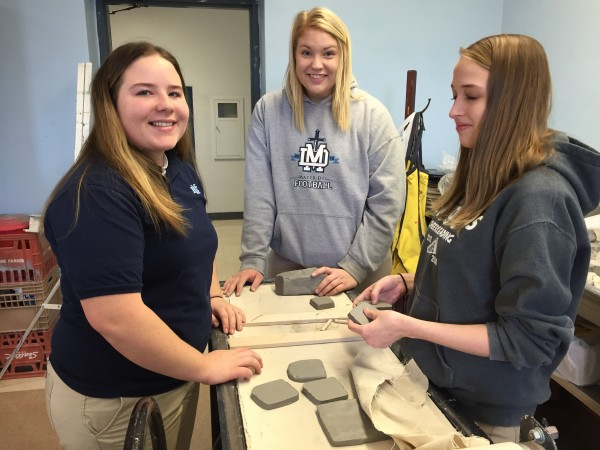 Katlyn Harpstrite, Amanda Boeckmann, and Morgan Brand work on a project in ceramic's class.
