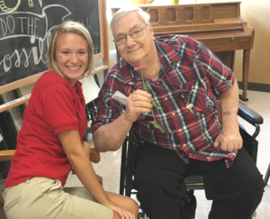 Melanie Holtgrave is pictured with a resident of Aviston Countryside Manor with whom she created poetry while attending a workshop led by Mr. Gary Glazer of the Alzheimer's Poetry Project.